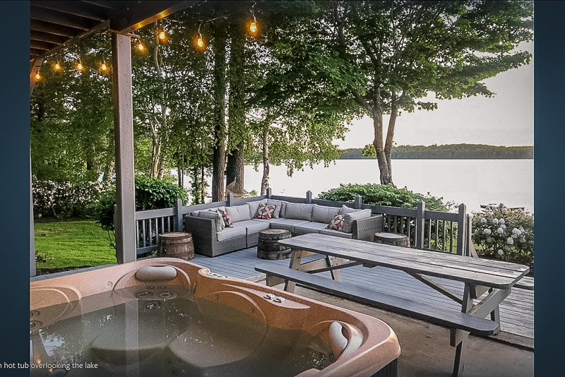 This Maine lake house to rent is equipped with a hot tub