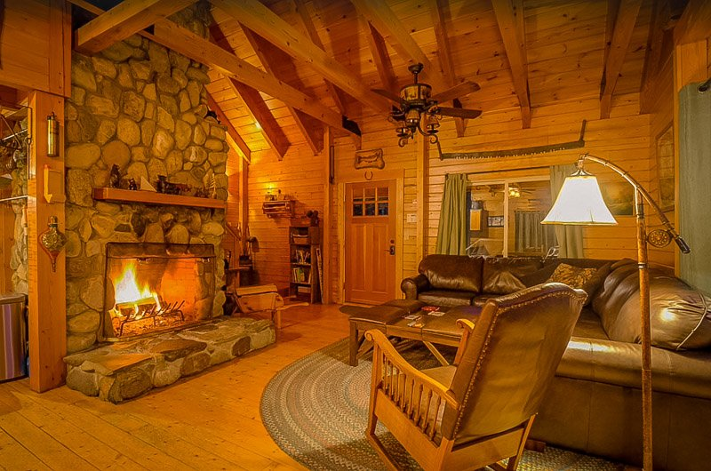 Living room with a cozy indoor fireplace