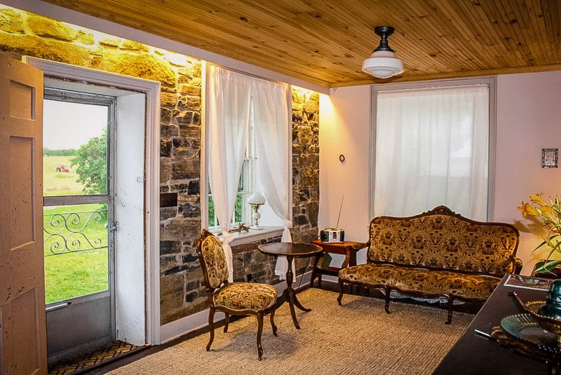 A lake house vacation rental in New York made from stone.