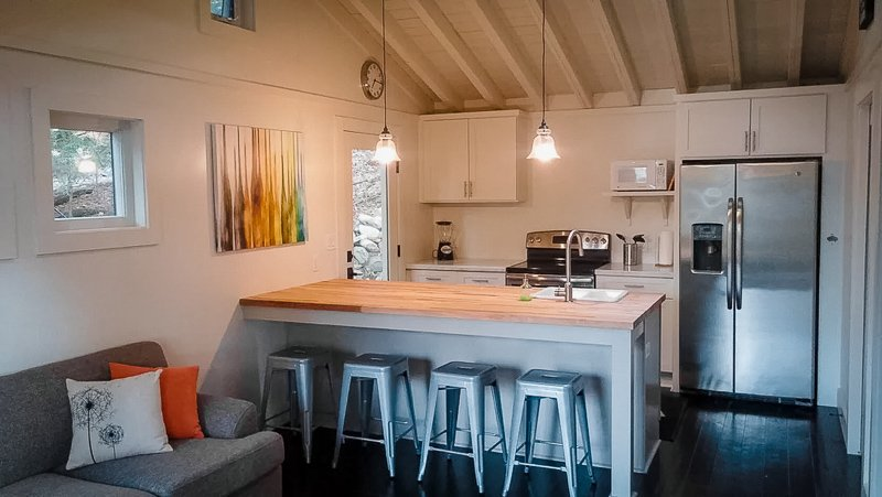 Quaint kitchen area inside this New York lakefront rental on Airbnb and VRBO