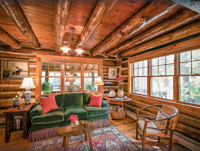 Rustic log cabin lake house rental in NY for all types of travelers.