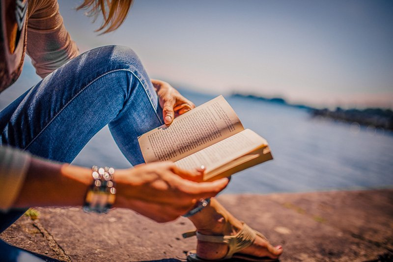 Reading a new book or classic novel is one of the top original bucket list ideas.
