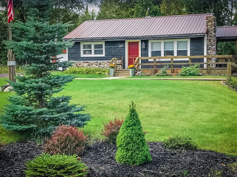 This Michigan lake house rental features a well-maintained lawn