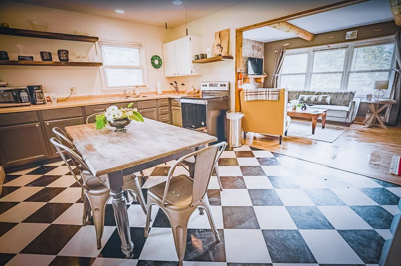 The kitchen and living room are cozy and stylish