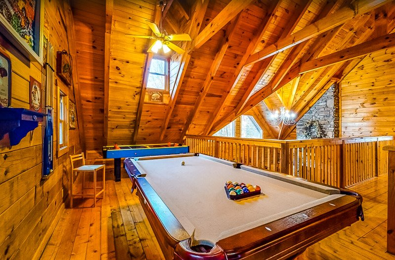 Play a game of pool at this fun Pigeon Forge rental cabin.