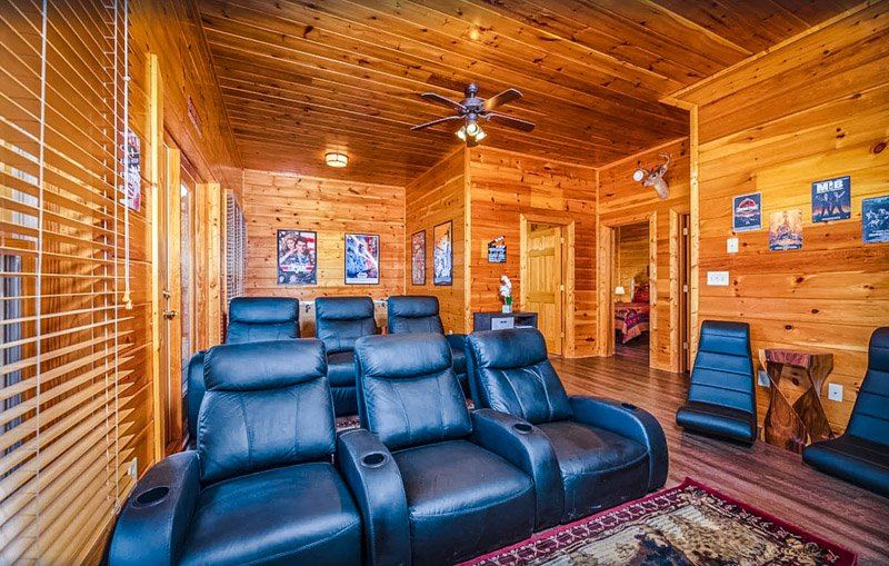 This cabin for rent comes with its own private movie theater.