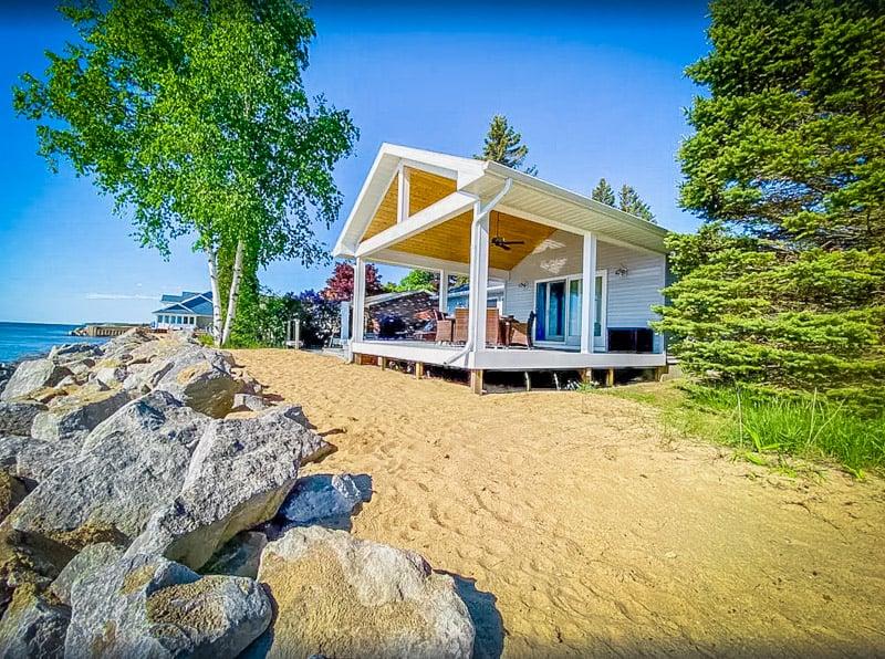 Sandy beaches give this Michigan lake house rental a tropical feel