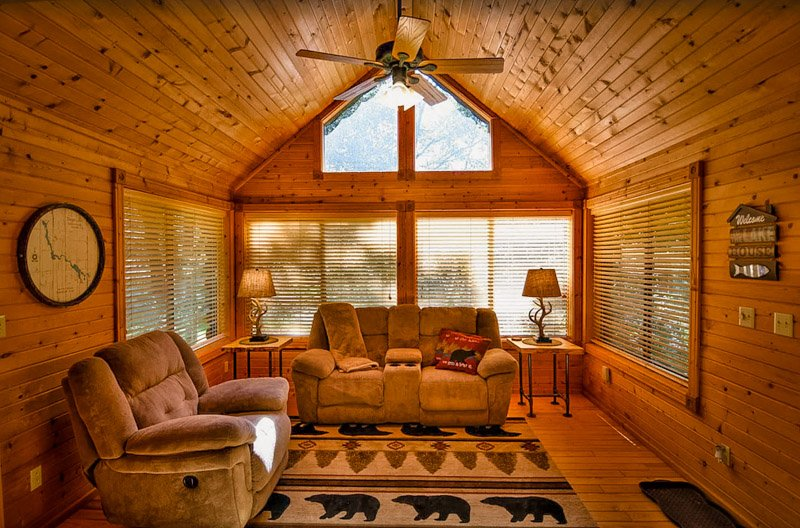 sitting area of this cabin on a lake in wisconsin